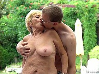Youthful nerdy dude pounding ash-blonde granny at pool