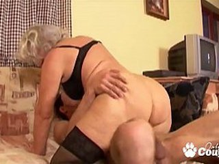 Granny whore degluting and pummeling ample cock