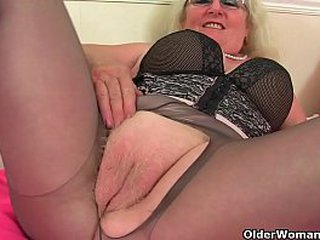 Chunky gilf Elle from the UK is feeling adventurous in black tights today. Bonus video: British granny Claire Knight.