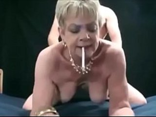Granny is fucked from behind by her boytoy while husband recording