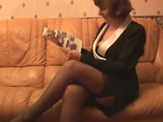 Hairy Granny in stockings plays with undies then strips