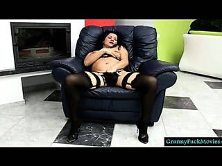 Granny with high heels and dark-hued stockings